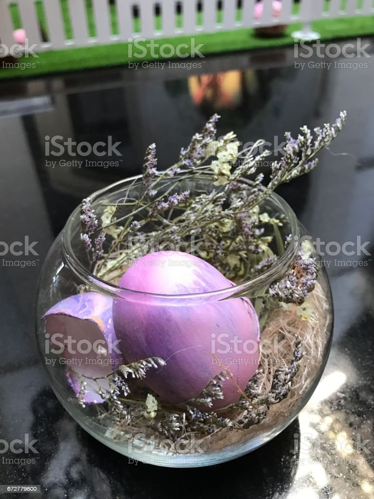 Easter egg or Paschal egg in the glass bowl. stock photo