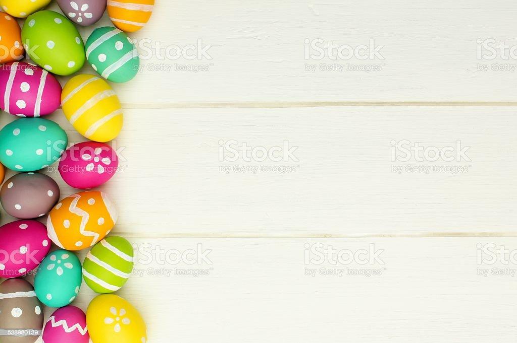 Easter egg side border against white wood stock photo