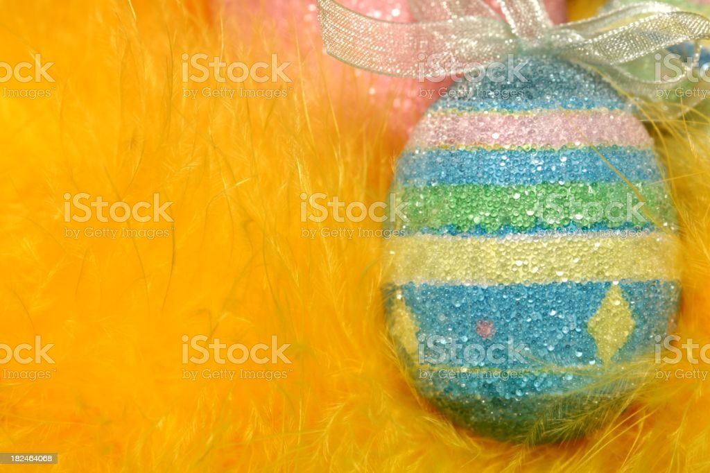 Easter egg with yellow feathers stock photo