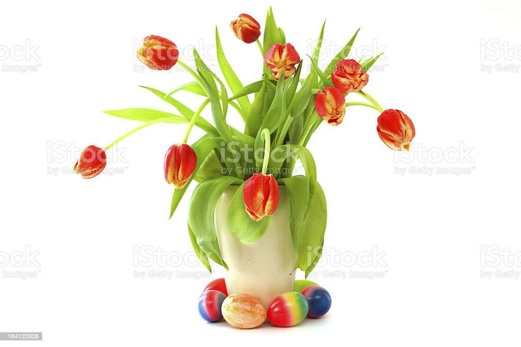Easter eggs and bunch of tulips. royalty-free stock photo