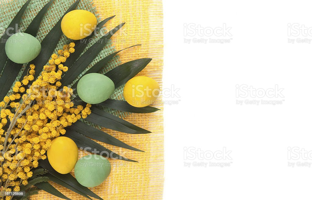 easter eggs and mimosa flowers stock photo