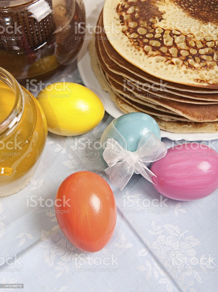 Easter eggs and pancakes royalty-free stock photo