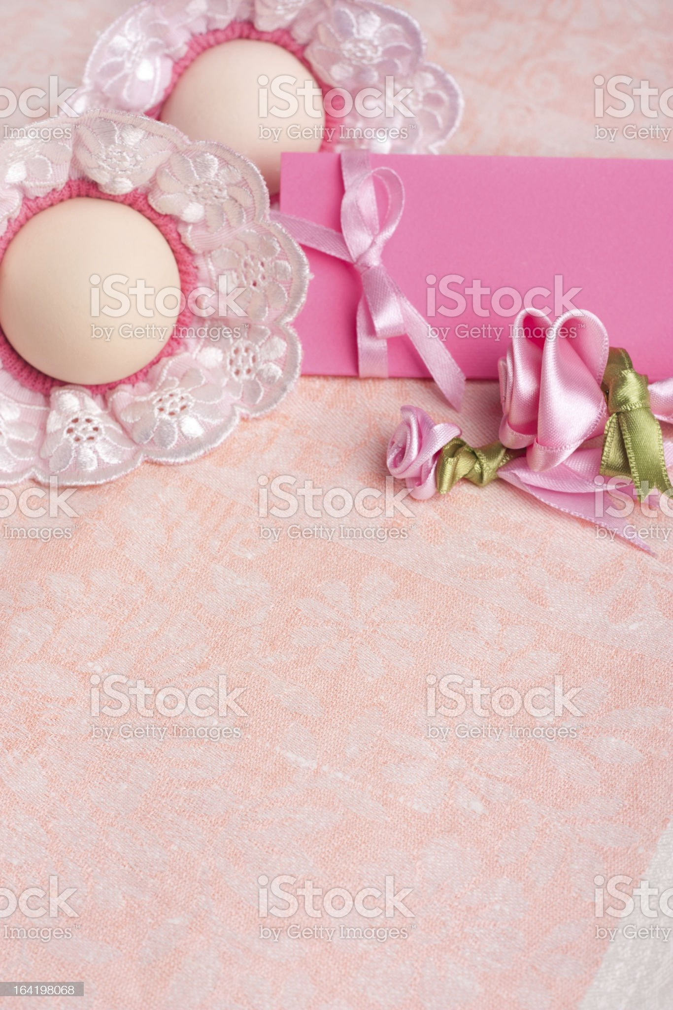 Easter eggs and red ribbon over pink background royalty-free stock photo