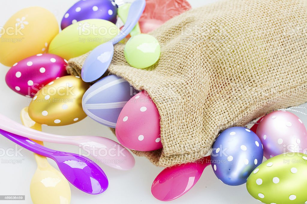 easter eggs and spoons stock photo