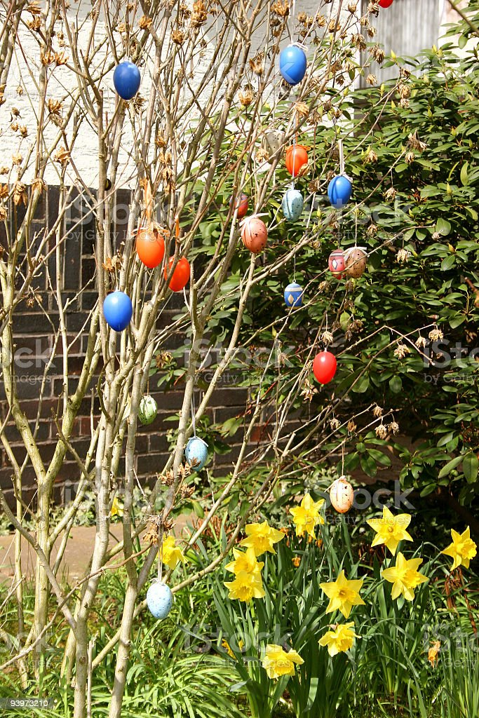 Easter eggs at branches in a garden royalty-free stock photo
