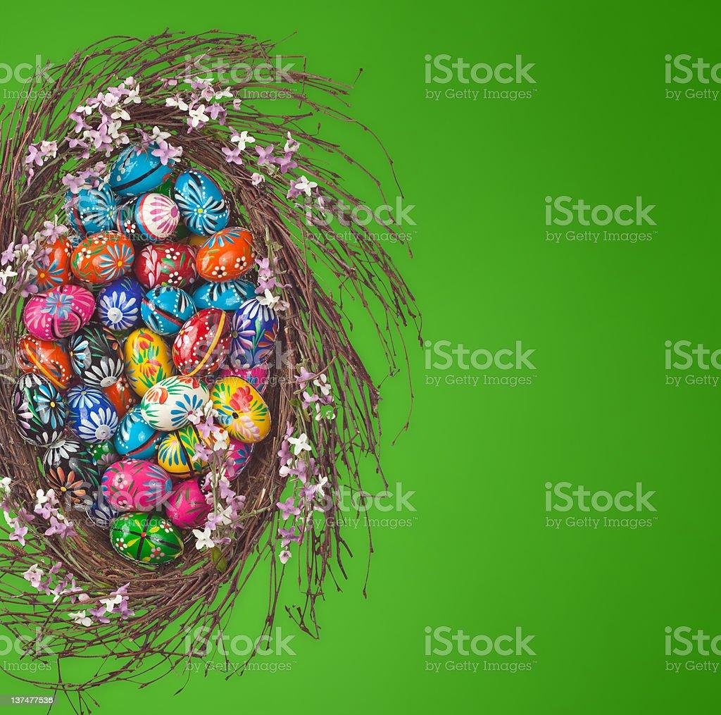 Easter Eggs basket arrangement on green royalty-free stock photo