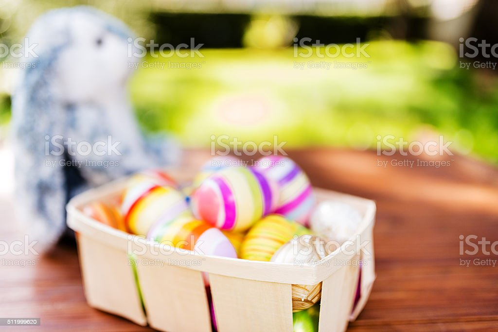easter eggs basket on plank wood stock photo