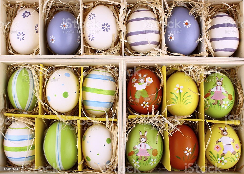 Easter eggs collection in wooden box closeup royalty-free stock photo