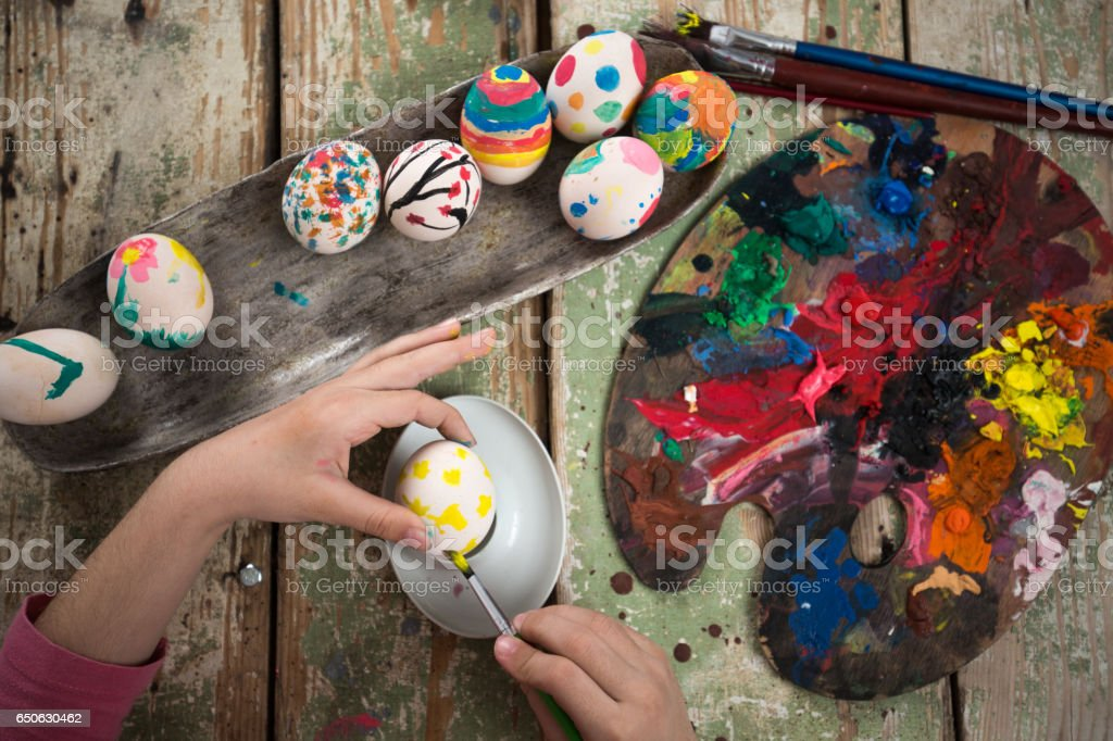 Easter eggs coloring project. Eggs aranged in an old bowl stock photo