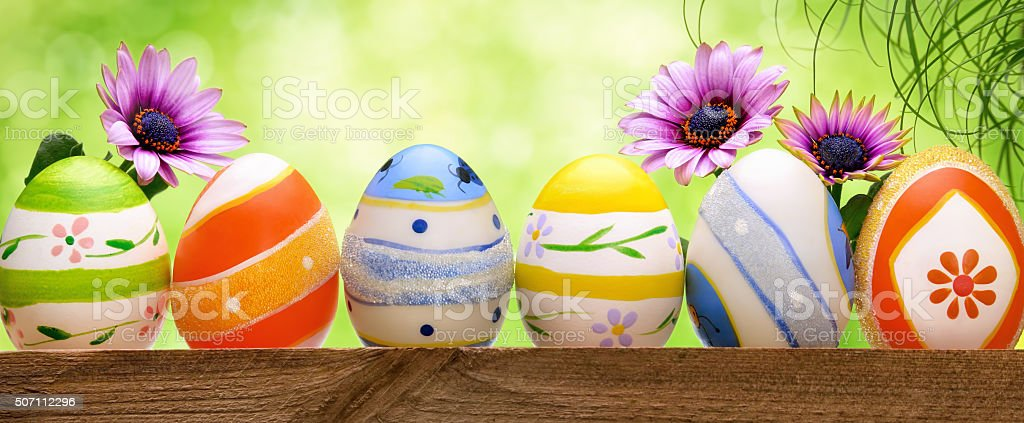 Easter eggs, flowers and bokeh background stock photo
