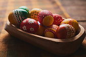Easter eggs hand painted on wooden background