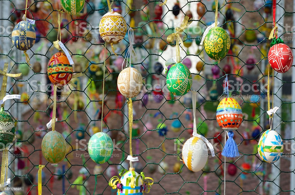 Easter eggs hung outdoors stock photo