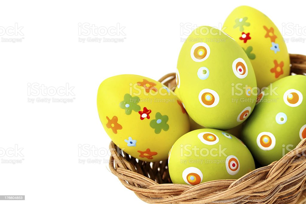 Easter eggs in a basket from bottom corner stock photo