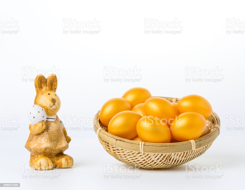 easter eggs in a basket on white background stock photo