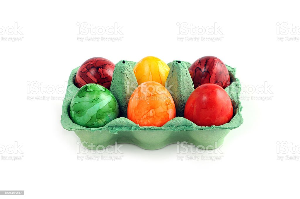easter eggs in a green carton aon white background stock photo