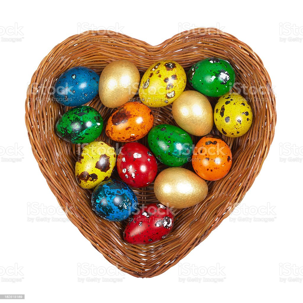 Easter Eggs in a heart-shaped basket stock photo