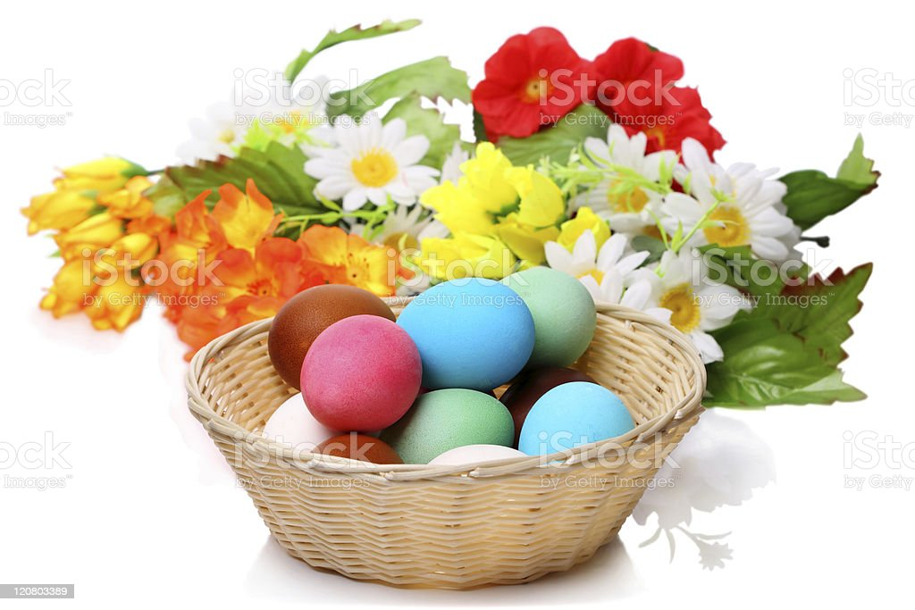 Easter eggs in a wicker basket royalty-free stock photo