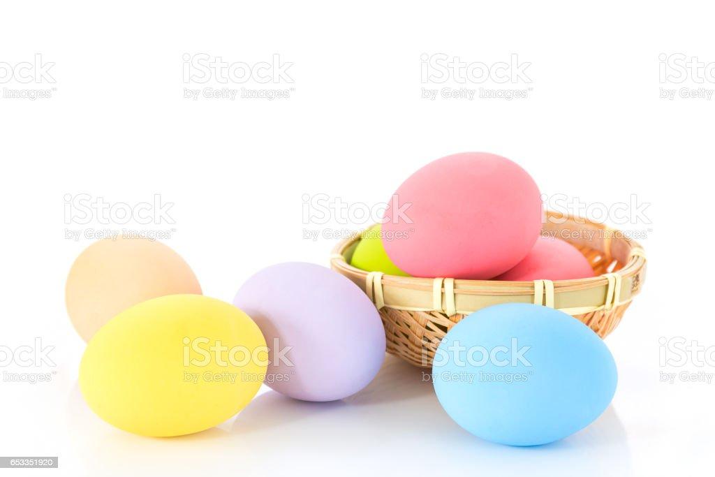 Easter eggs in basket on white stock photo