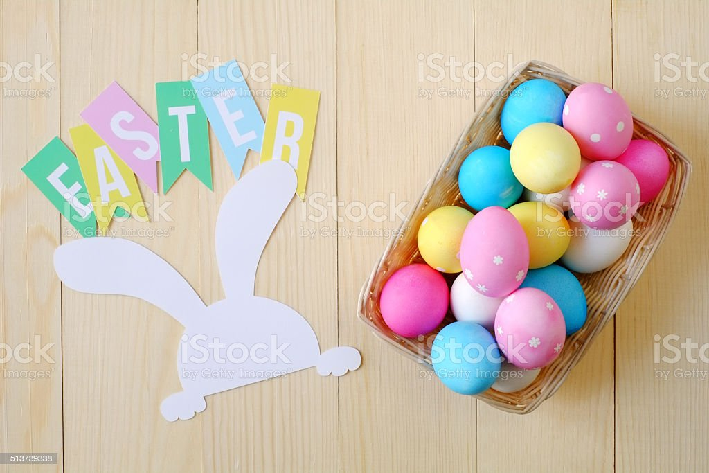 Easter Eggs in Basket Top View stock photo