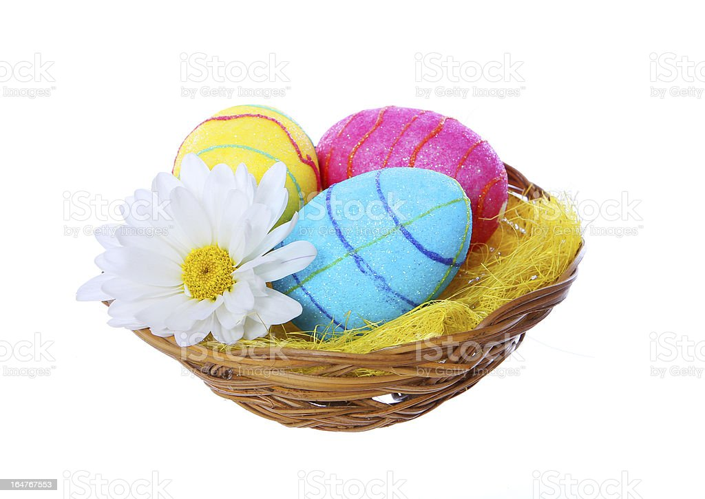 easter eggs in basket with chamomile flower isolated royalty-free stock photo