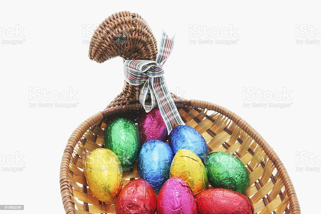 Easter Eggs in Chicken Basket royalty-free stock photo