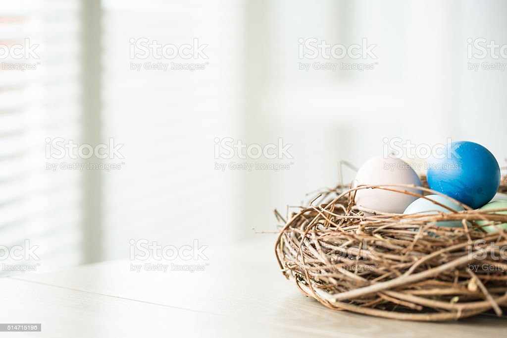 Easter eggs in nest with copy space stock photo