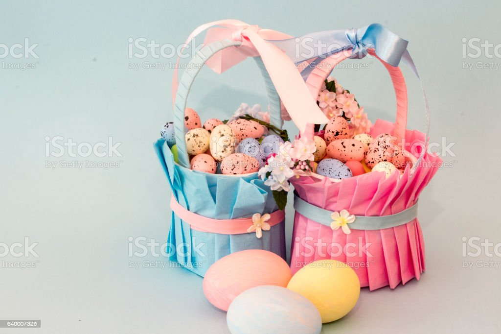 Easter Eggs in Pink and Blue Easter Baskets. stock photo