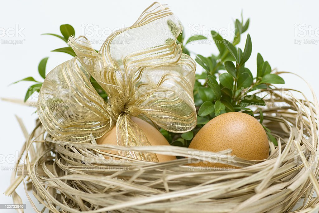 Easter eggs in straw royalty-free stock photo