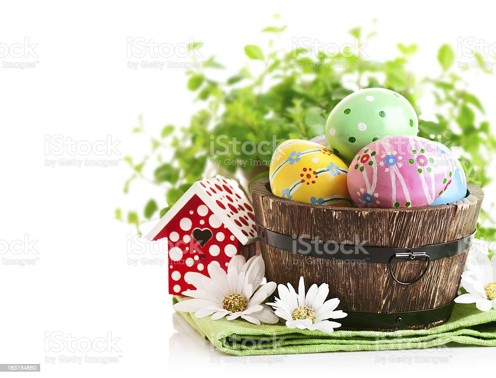 Easter eggs in the pot with green grass royalty-free stock photo