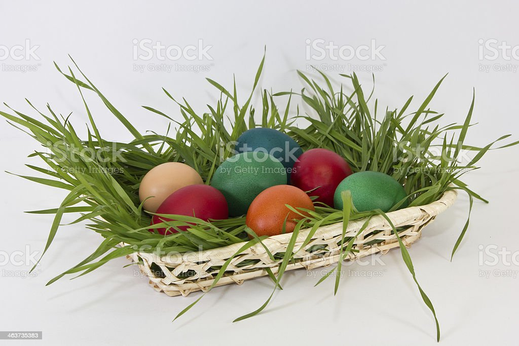 Easter eggs in wicker vase royalty-free stock photo