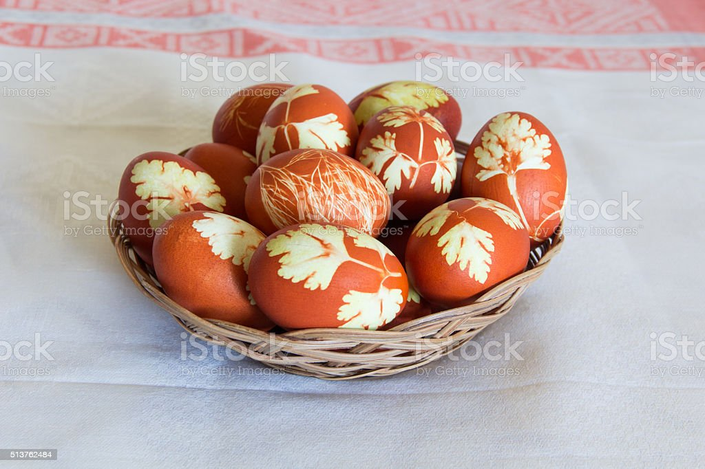 Easter eggs in wickerwork plate stock photo