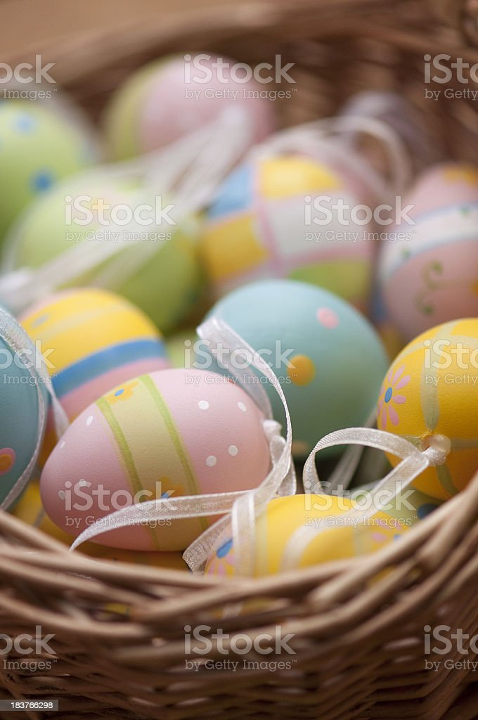Easter eggs in wooden egg basket royalty-free stock photo