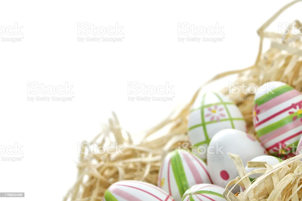 Easter eggs into a nest from bottom corner stock photo