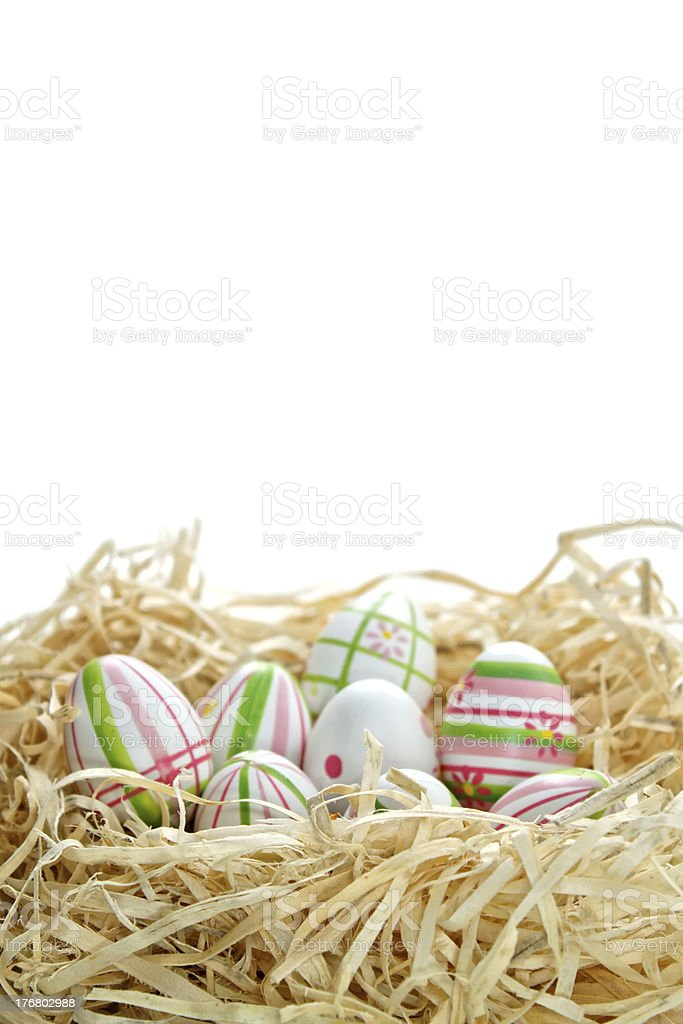 Easter eggs into a nest from bottom royalty-free stock photo