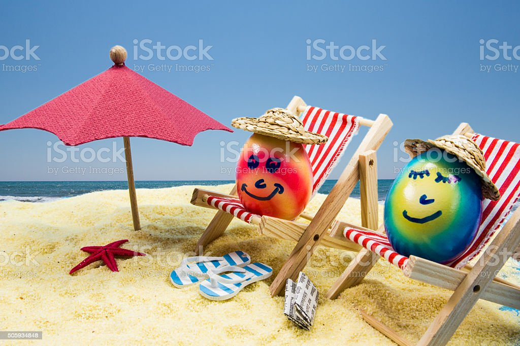 easter eggs make holiday at the beach stock photo