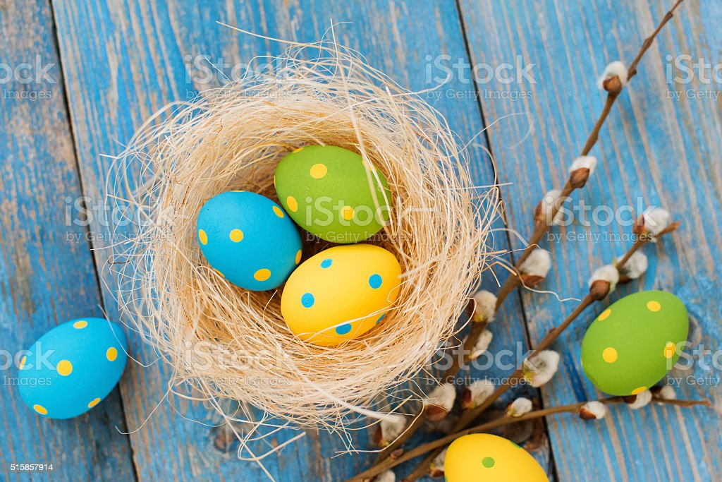 Easter eggs on a blue wooden background stock photo