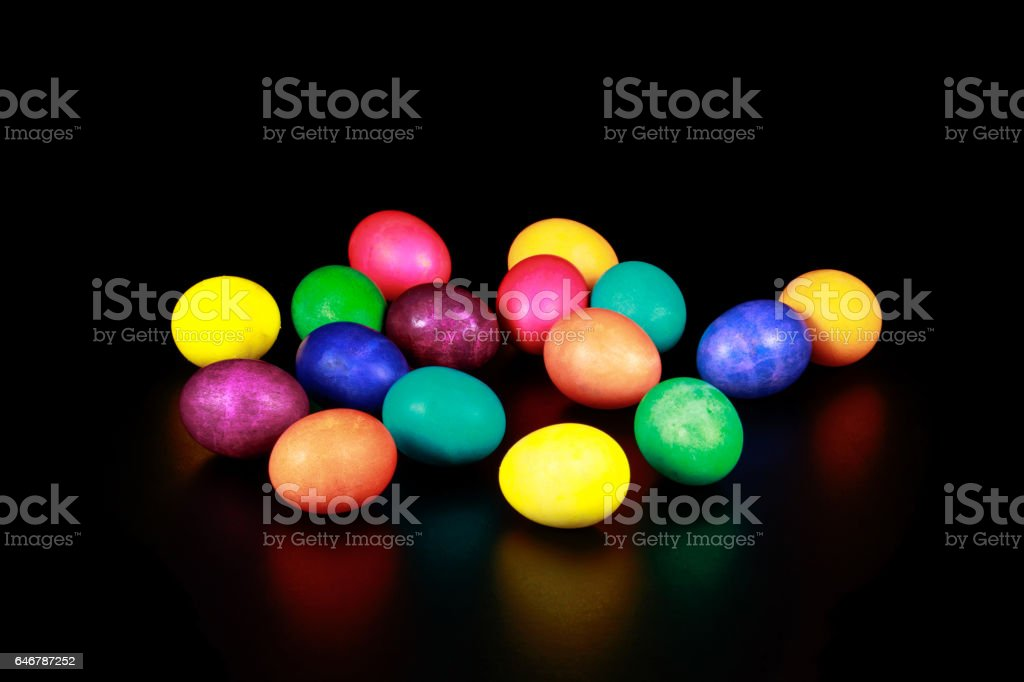 Easter eggs on a semi-reflective black surface. stock photo