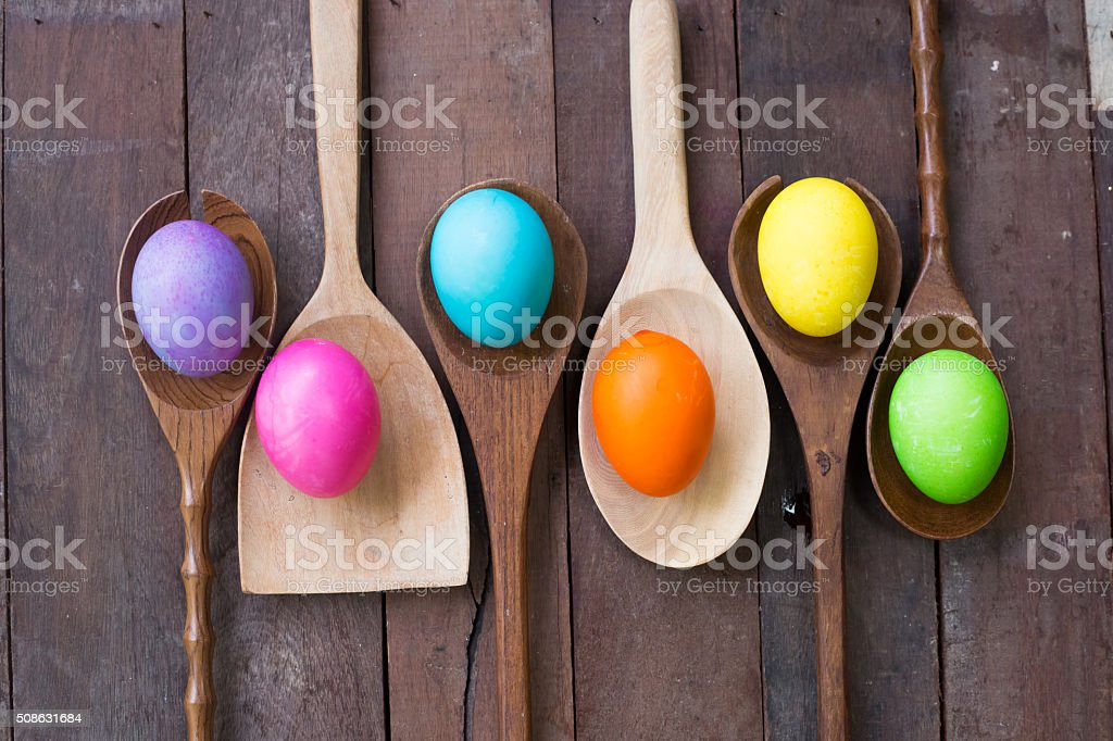 Easter eggs  on a Wooden kitchenware and wood background stock photo