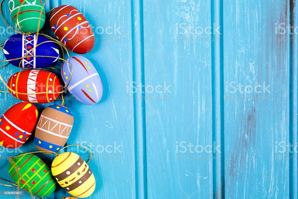 Easter eggs on blue wood. Seasonal background frame. stock photo