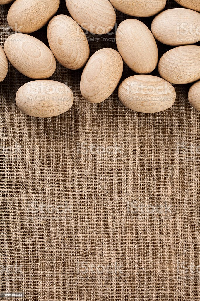 Easter eggs on hemp bag, text place, background royalty-free stock photo
