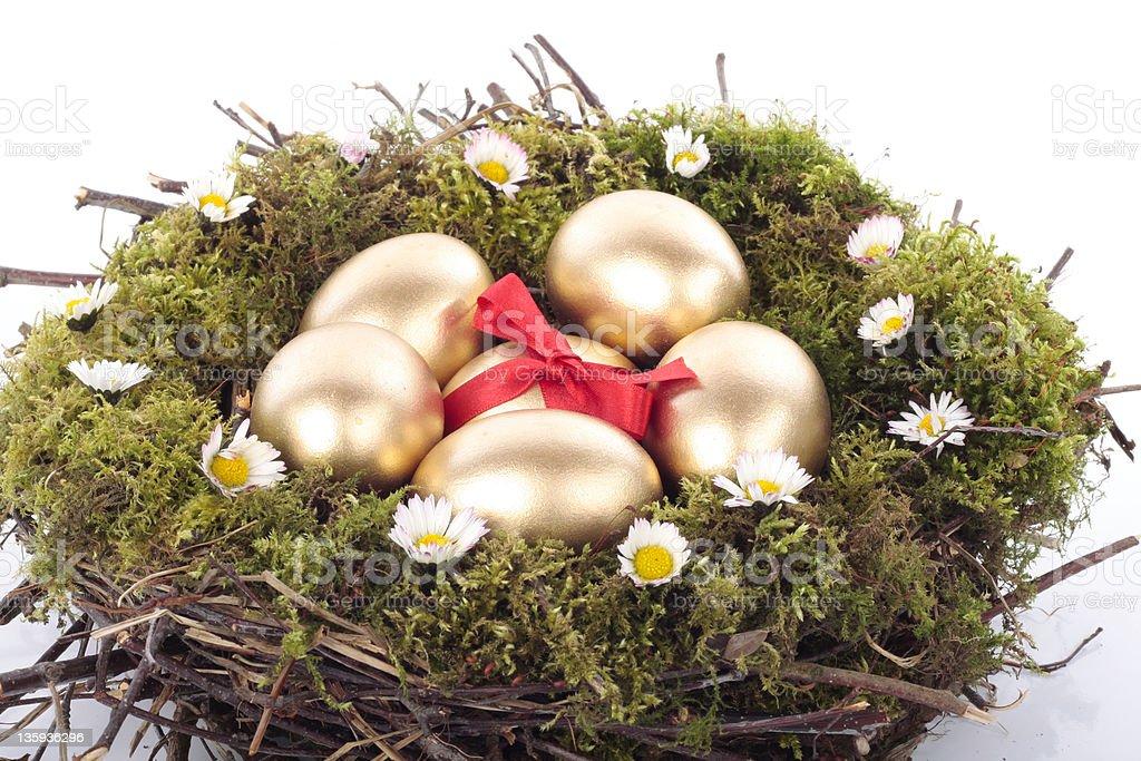 Easter eggs on  nest over white royalty-free stock photo