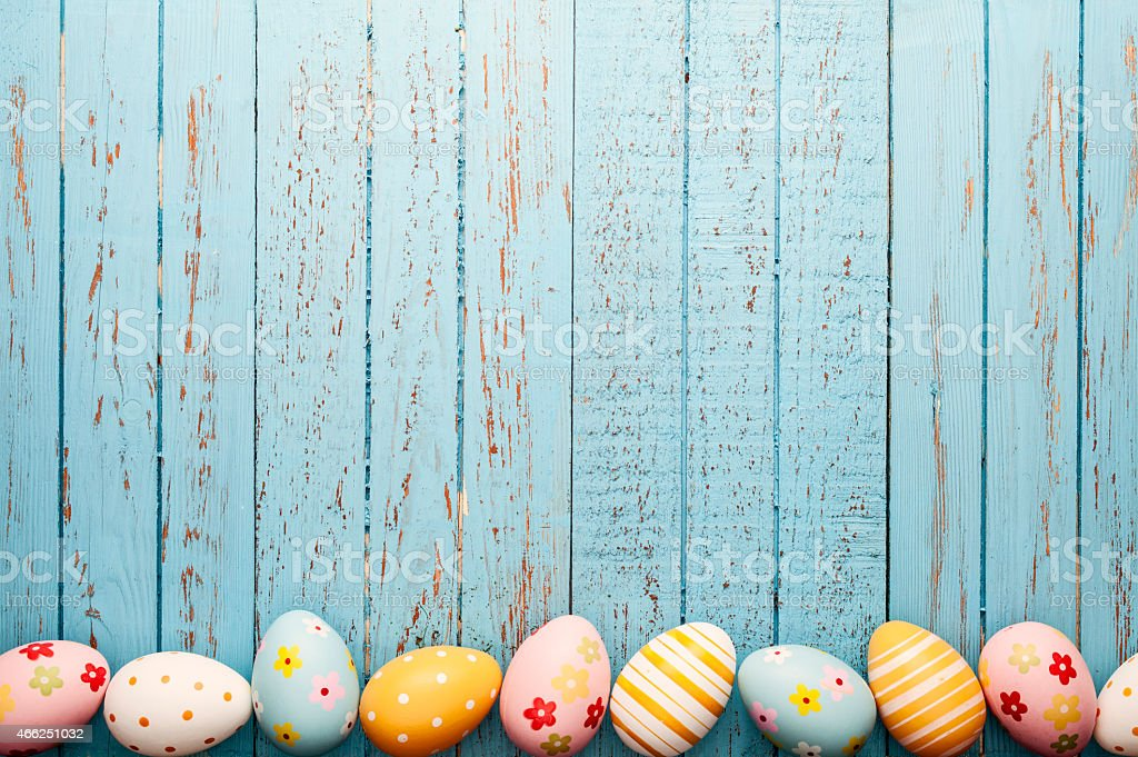 Easter Eggs on Old Blue Wood - Season Background Frame stock photo