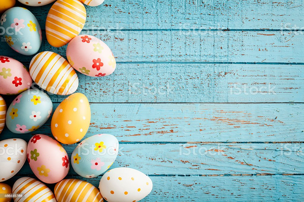 Easter Eggs on Old Blue Wood - Season Background Frame stock photo