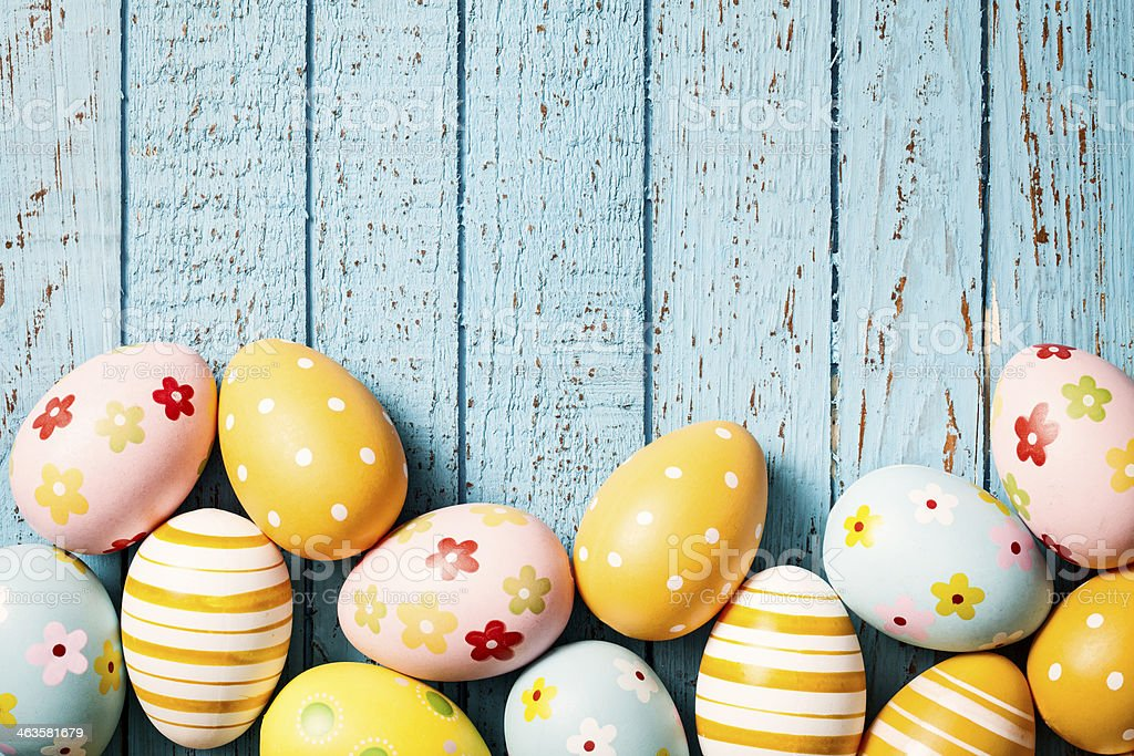 Easter Eggs on Old Blue Wood - Season Background royalty-free stock photo