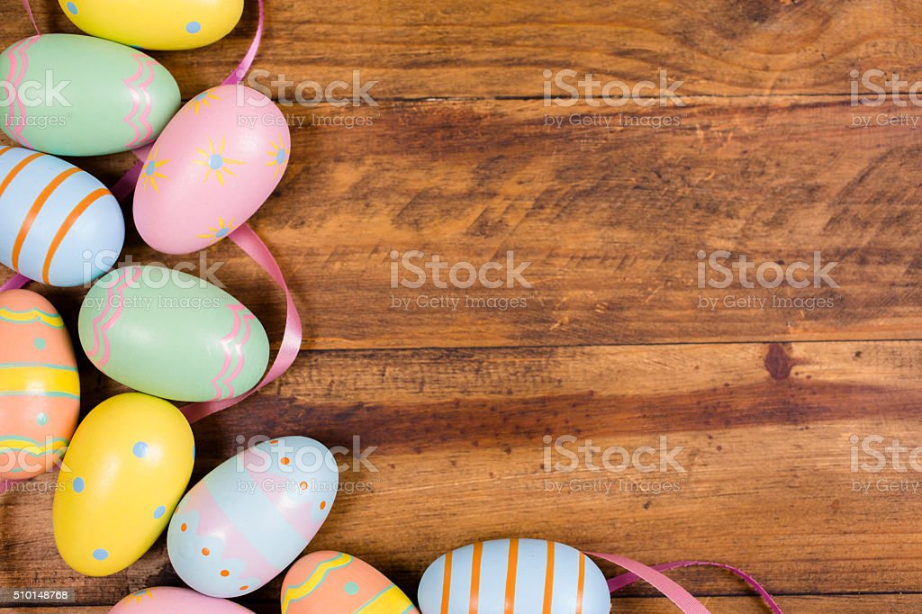 Easter eggs on rustic wood table. Seasonal background frame. stock photo