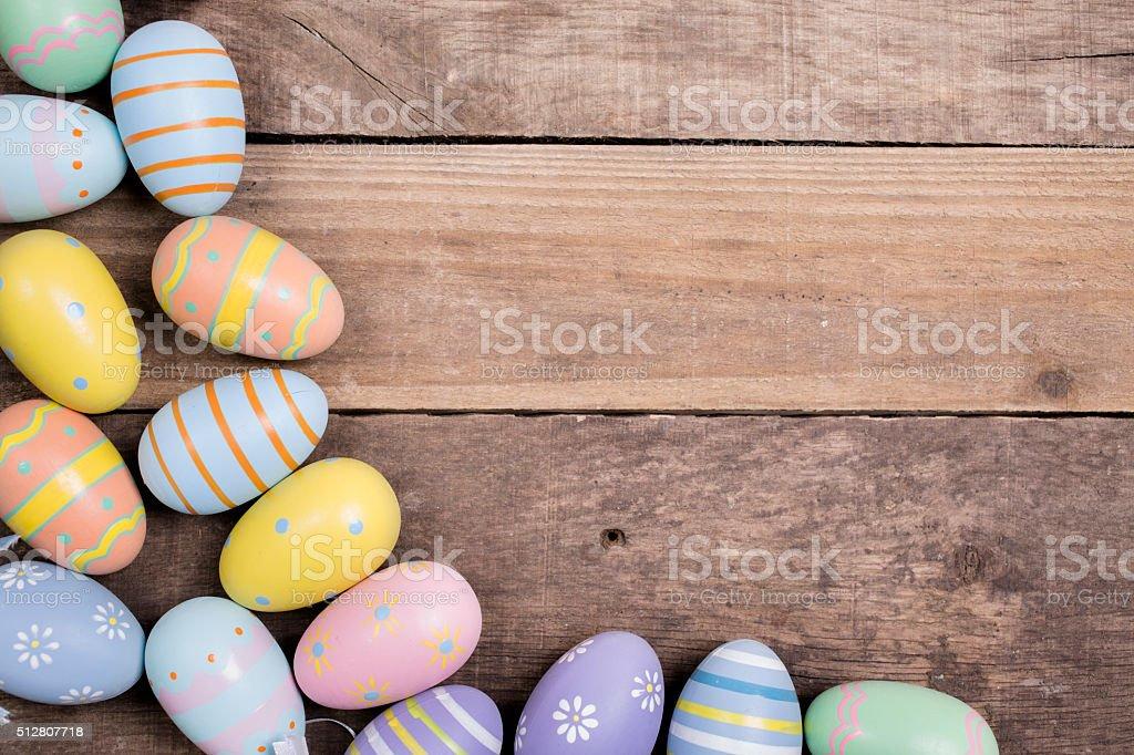 Easter eggs on rustic wood table. Seasonal background frame. stock photo