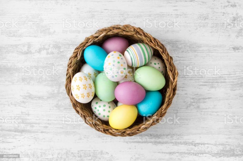 Easter Eggs on White Wooden Table Background stock photo