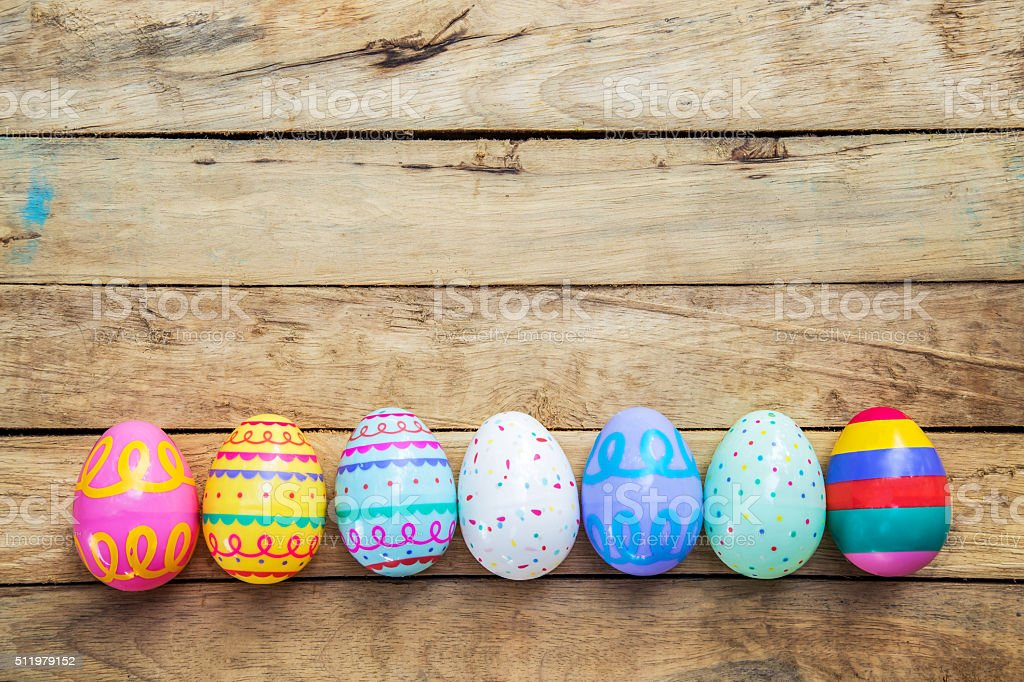 Easter eggs on wooden background with space stock photo