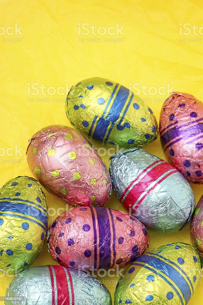 Easter eggs on yellow stock photo