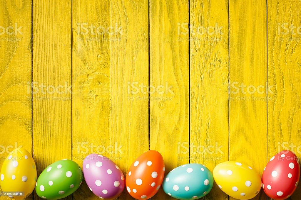 Easter Eggs on yellow Wood - Season Background stock photo